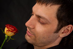 Portrait of man with rose. Stock Photo