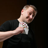 Portrait of the man with royal flush Royalty Free Stock Photos