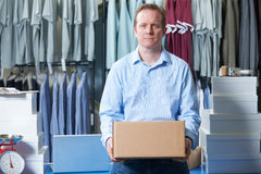 Portrait Of Man Running On Line Clothing Business. Man Running On Line Clothing Business Royalty Free Stock Images