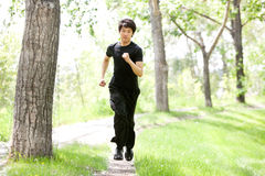 Portrait of man running in a park Royalty Free Stock Images