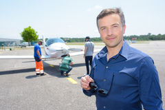 Portrait man on runway with light aircraft Stock Images
