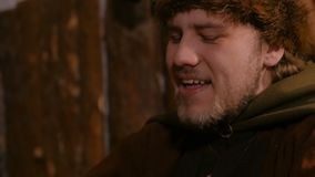 Portrait of man in russian ethnic suit laughing. Folk, fun and traditional concept stock footage