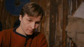 Portrait of man in russian ethnic suit playing chess. Portrait of man in russian ethnic suit playing board game like chess. Folk, competition and traditional stock footage