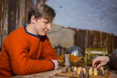 Portrait of man in russian ethnic suit playing chess Royalty Free Stock Photography