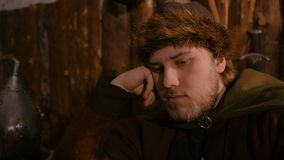 Portrait of man in russian ethnic suit playing chess. Portrait of pensive man in russian ethnic suit playing board game like chess. Folk, competition and stock video footage