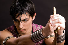 Portrait of man with saber. Portrait of young serious man with saber Royalty Free Stock Photography