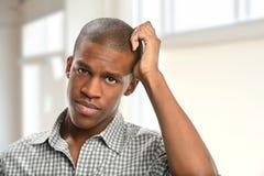 Portrait of Man Scratching Head Stock Photos