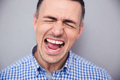 Portrait of a man screaming Stock Photo