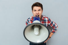 Portrait of a man screaming in megaphone Royalty Free Stock Photography