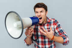 Portrait of a man screaming in megaphone Stock Image