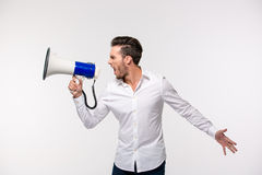 Portrait of a man screaming in megaphone Royalty Free Stock Photo