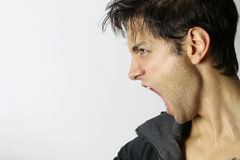 Portrait of a man screaming in rage. On a white background Stock Photos