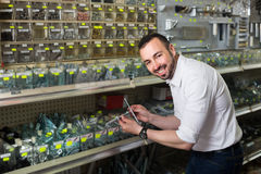 Portrait of man selecting rawlplug. In household department Stock Images