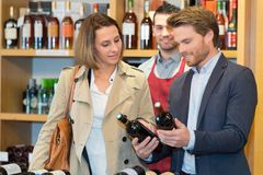 Portrait man selling wine during wine tasting Royalty Free Stock Photo