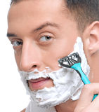 Portrait of man that shaving with foam Royalty Free Stock Photography