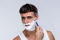Portrait of a man shaving Royalty Free Stock Images
