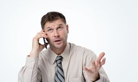 Portrait of a man in shirt and tie talking on smartphone stock photos