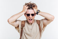 Portrait of a man shouting with hands over his head Royalty Free Stock Photography