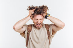 Portrait of a man shouting with hands over his head Royalty Free Stock Photos