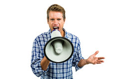 Portrait of man shouting through megaphone Stock Photography