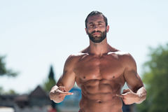 Portrait Of A Man Showing Abs Outdoors. Portrait Of A Physically Fit Man Showing Abs Outdoors royalty free stock image