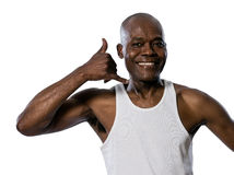 Portrait of man showing call me gesture. Portrait of a friendly afro American man showing call me gesture in studio on white isolated background Stock Photography