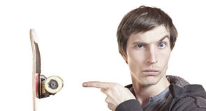 Portrait of a man showing his skateboard Stock Images