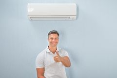 Portrait of a man showing thumb-up sign Stock Image