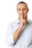 Portrait of a man with silent gesture Stock Images