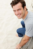 Portrait of man sitting by beach Royalty Free Stock Photography