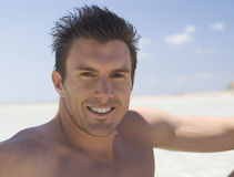 Portrait of a man sitting on a beach Royalty Free Stock Photo