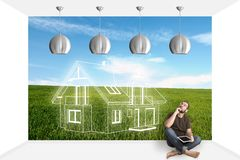 Portrait Of Man Sitting On Floor Looking Up. Man sitting on the floor and dreaming about a new home Stock Images