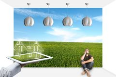Portrait Of Man Sitting On Floor Looking Up. Man sitting on the floor and gets home design on the tablet stock photo