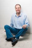 Portrait of man sitting on the floor royalty free stock photo