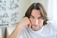 Portrait of man sitting in living room Stock Photography