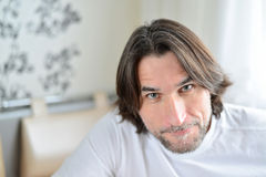 Portrait of man sitting in living room Stock Photos