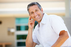 Portrait man sitting outdoors Royalty Free Stock Photos