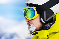 Portrait of man in ski googles and snow on beard Royalty Free Stock Photography