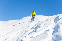 Portrait of man skiing downhill in high mountains Stock Photo