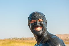 A portrait of a man smeared in mud and smiling royalty free stock photos