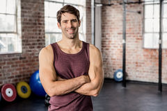 Portrait of man smiling with arms crossed Royalty Free Stock Image