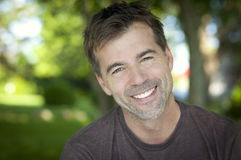 Portrait Of A Man Smiling At The Camera stock photos