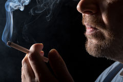 Portrait man smoking cigarette Stock Image