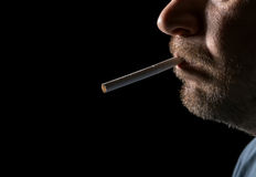 Portrait man smoking cigarette Stock Photo
