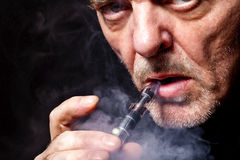 Portrait of a man smoking an e-cigarette Royalty Free Stock Image