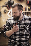 Portrait of a man smoking pipe in wood workshop Royalty Free Stock Images