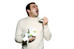 Portrait man sneezing cold and flu allergy. Portrait of a caucasian  man sneezing cold and flu allergy in studio isolated on white isolated background Stock Photo