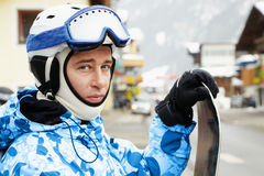 Portrait of man snowboarder in ski suit royalty free stock photo