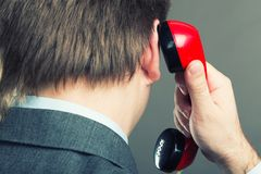 Portrait of a man speaking phone isolated on gray Royalty Free Stock Photos