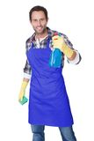 Portrait of a man with sponge and spray Royalty Free Stock Image